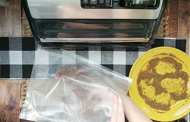 Placing lamb chops in a foodsaver bag