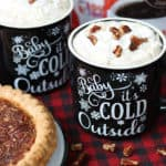 Two mugs of pecan pie coffee topped with whipped cream
