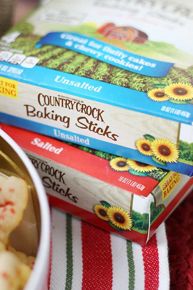 Country Crock Baking Sticks next to a tin of cookies