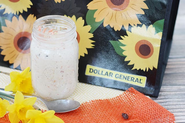Overnight oats in a mason jar in front of a reusable shopping bag