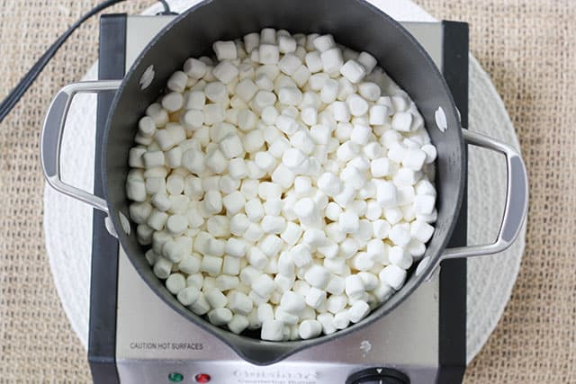 Mini marshmallows in a large pot on a stovetop
