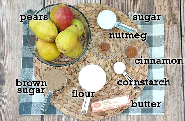 Ingredients for pear pie on a placemat