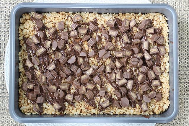 Peanut butter Reese cup rice krispie treats in a baking pan