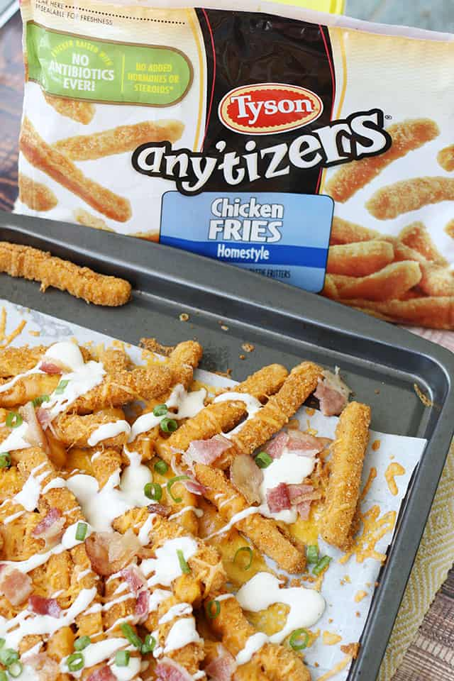 A bag of Tyson Chicken Fries behind a cookie sheet with loaded chicken fries
