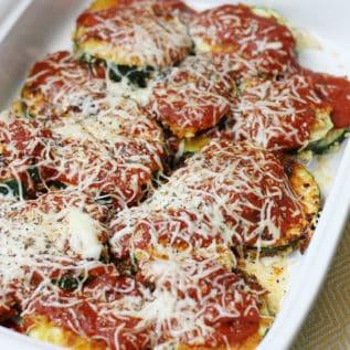 Zucchini parmesan in a white baking dish casserole