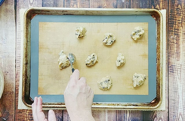 Scooping cookie dough onto a cookie sheet