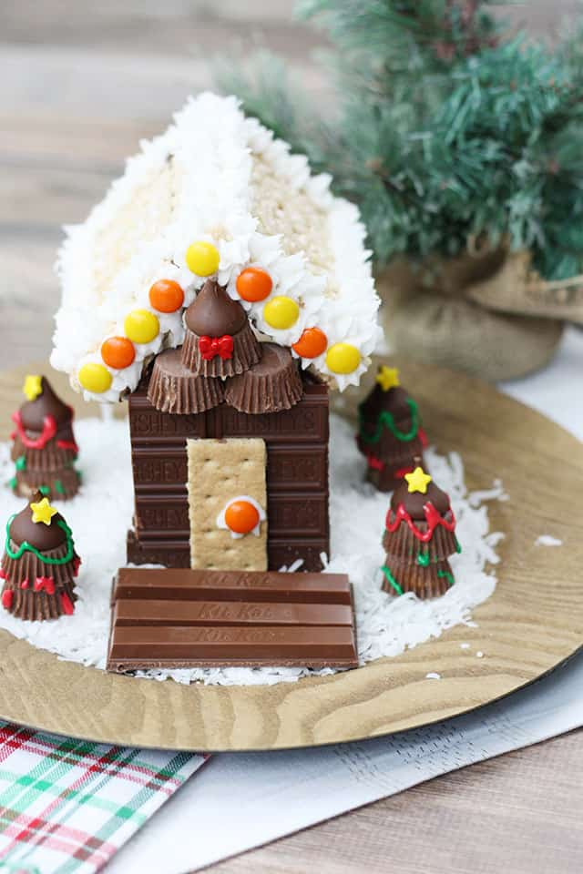 Candy Cabin centerpiece on a wooden charger on a table for decoration