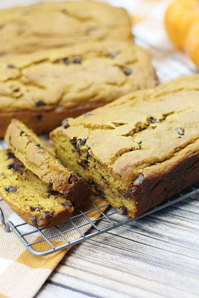 Chocolate chip pumpkin bread loaves sliced on a wire rack