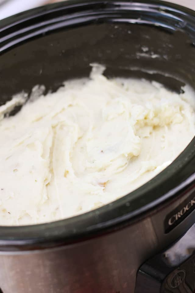 Slow cooker mashed potatoes kept warm in the crockpot
