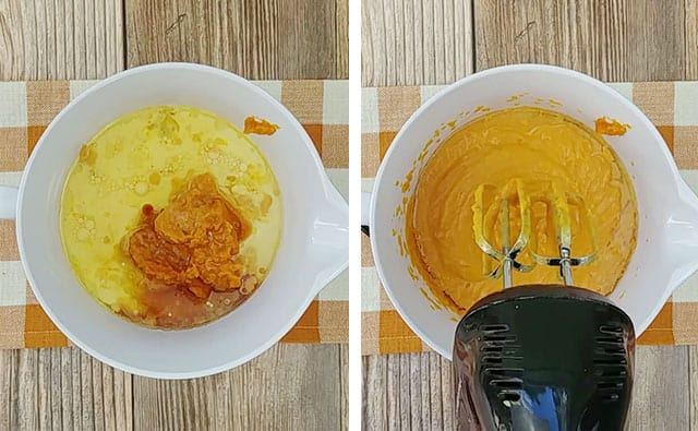 Beating wet ingredients with a hand mixer in a white mixing bowl