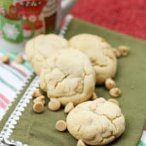 Peanut butter chip cookies on a green napkin next to a coffee mug