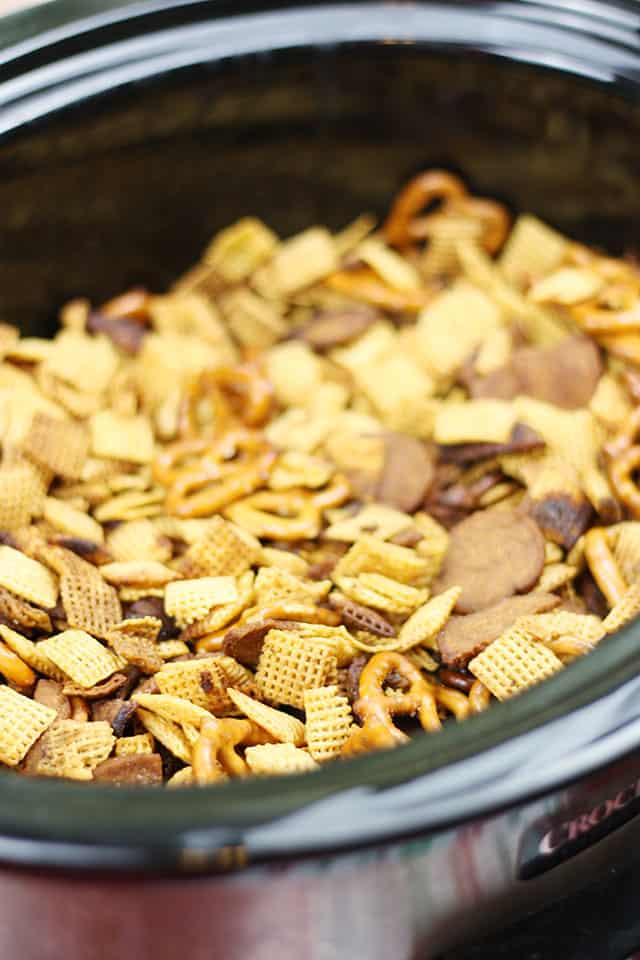Finished Crockpot Chex Mix in a black Crockpot