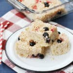 Berry cheesecake rice krispie treats on a white plate