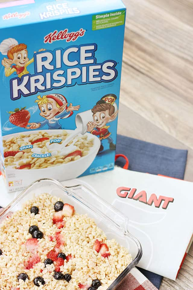 A box of rice krispies next to berry krispie treats