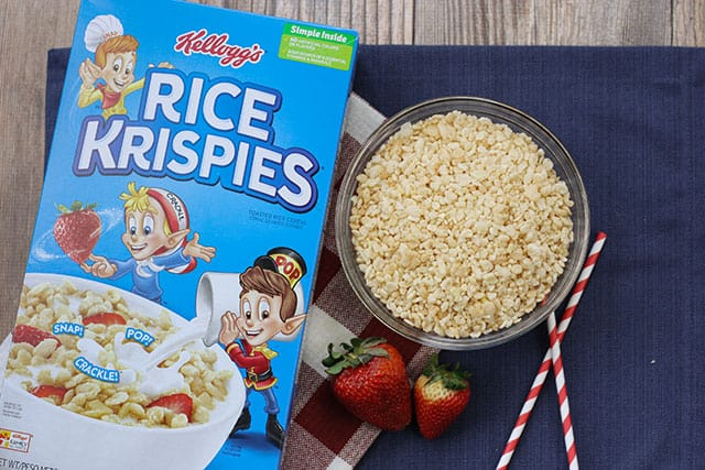 A bowl of rice krispies next to a box