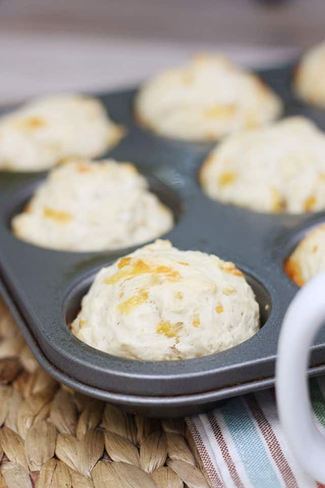 Beer bread muffins in a silver muffin tin
