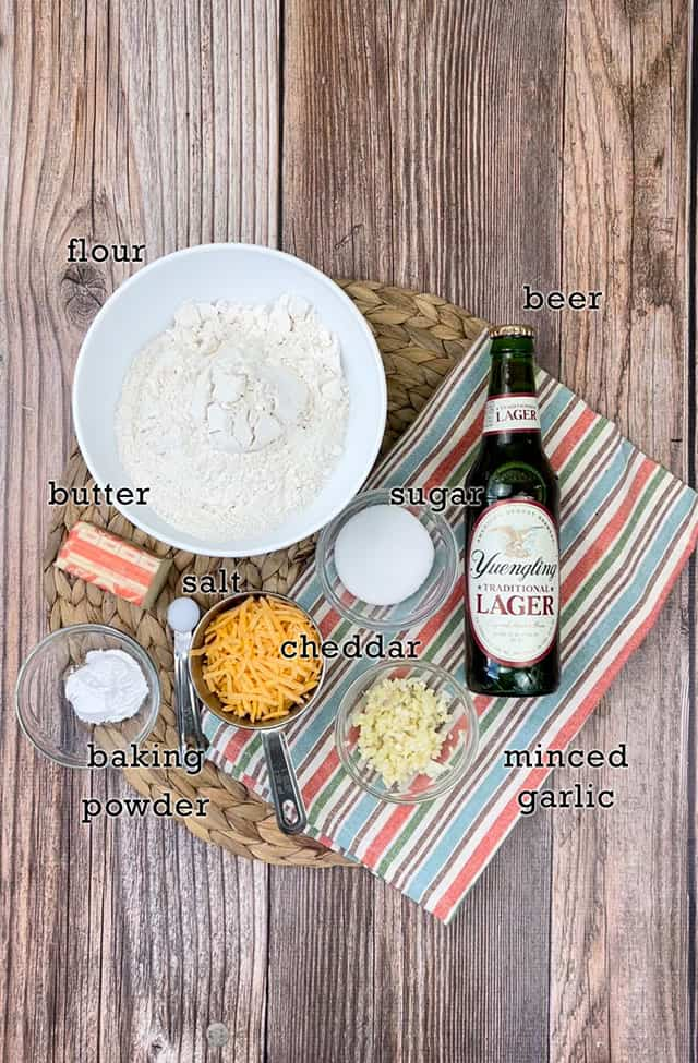Ingredients for beer bread muffins on a placemat