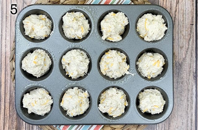 Beer bread muffin in a muffin tin about to be put into the oven
