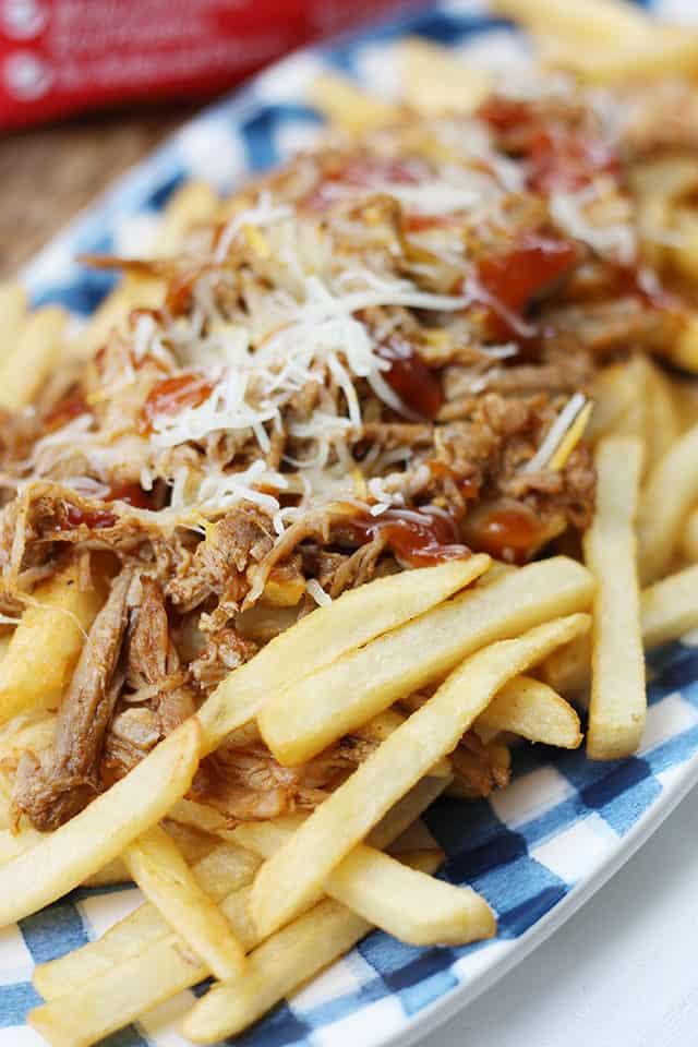 Pulled pork fries on a blue plaid serving platter