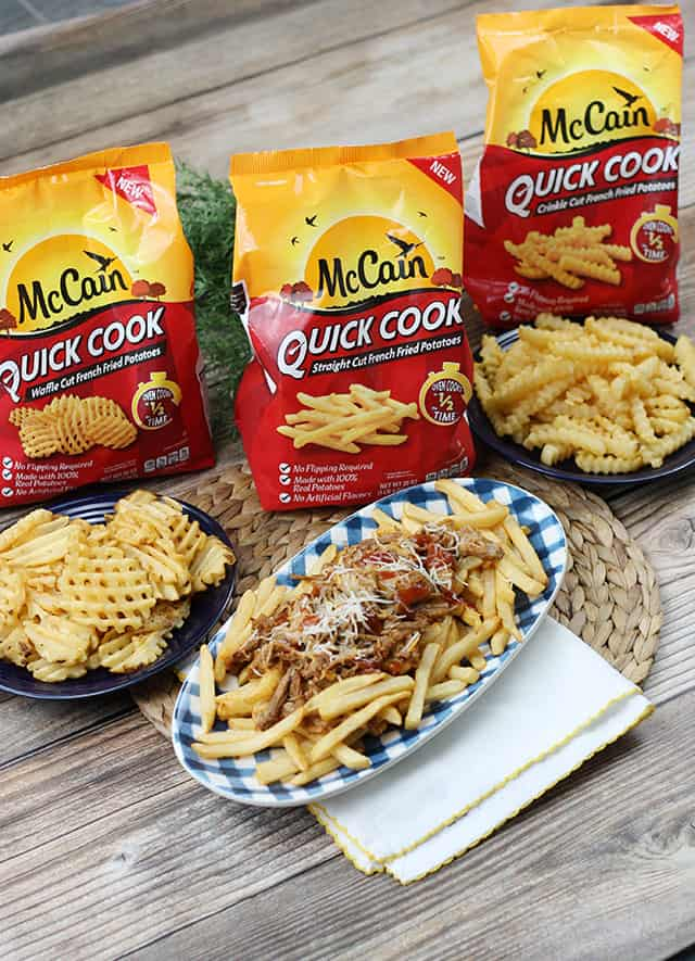 Pulled Pork Fries on a plaid plate in front of McCain Quick Cook frozen fries
