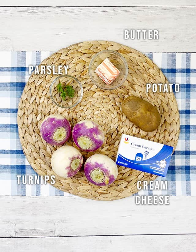 Ingredients for mashed turnips on a straw placemat